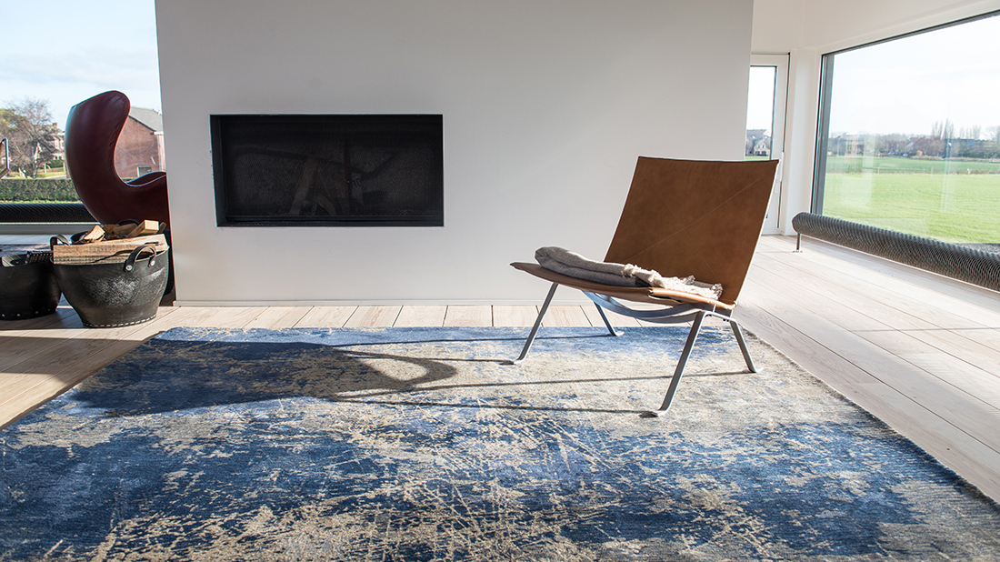 Cracked blue rug with chair