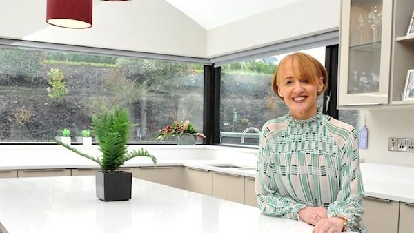 Portrait of Sinead Cassidy in a bright modern kitchen