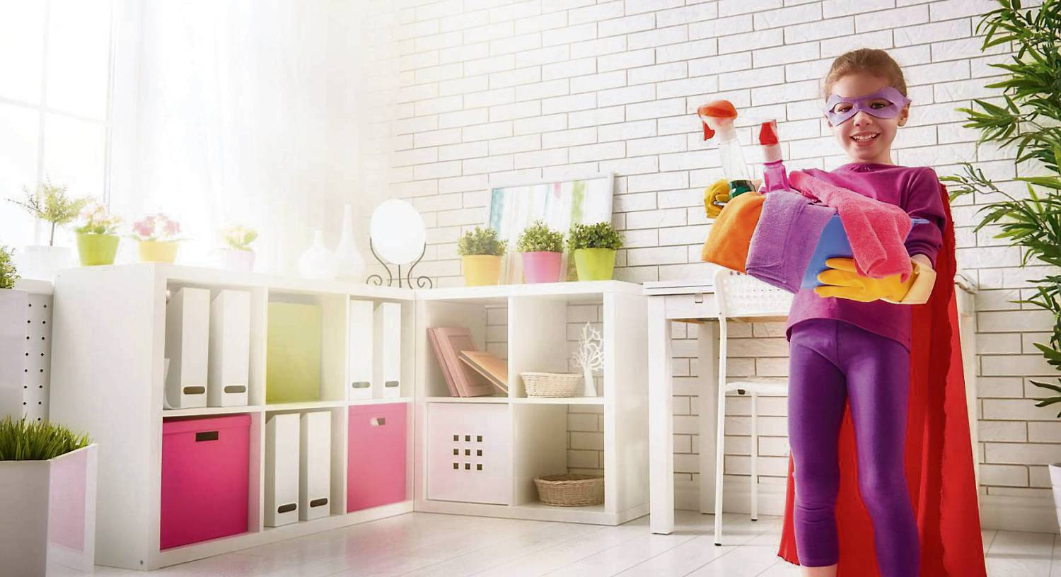 Superhero child white room with plants and boxes