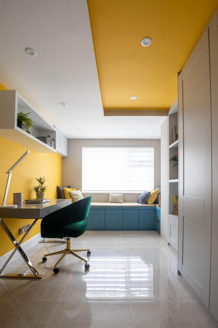 Home office design with painted yellow ceiling detail