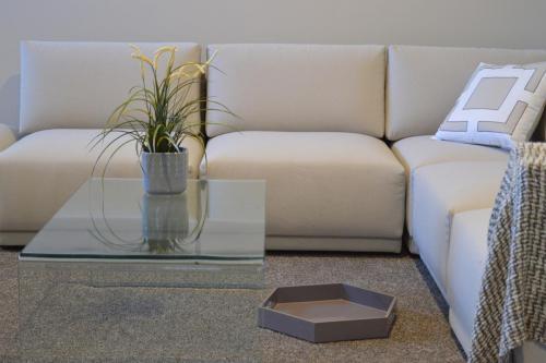 Cream corner sofa, glass coffee table