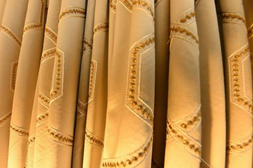 Champagne coloured curtains with gold embellishment - Sinead Cassidy Design