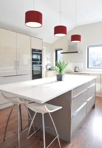 Bright kitchen with red lampshades